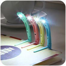 1 pcs Alta Qualidade Mini criativa Lâmpada de Leitura Luz do Livro LEVOU Clipe na Viagem Portátil, Frete grátis.(China (Mainland))