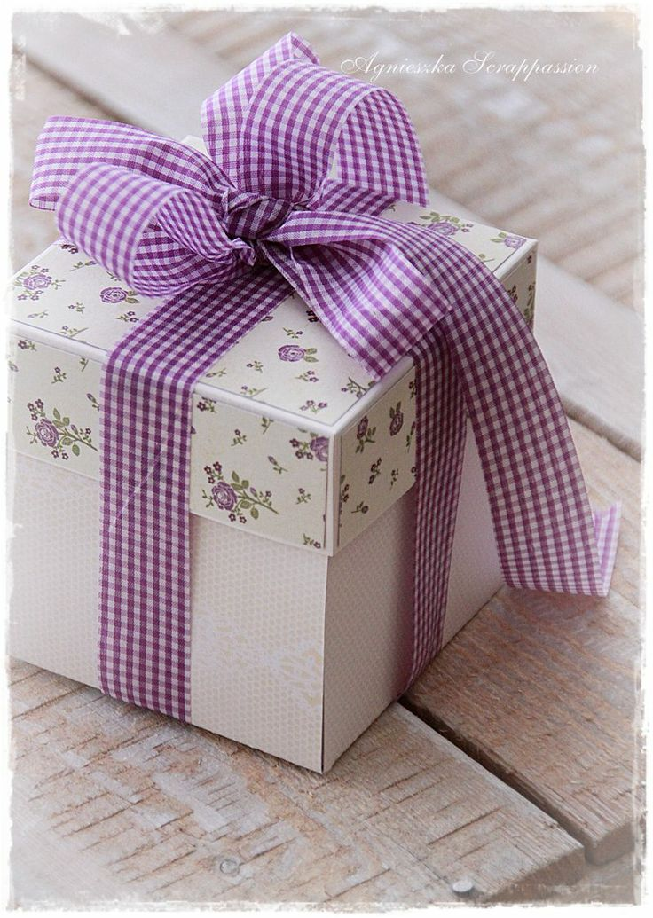 Floral paper and purple ribbon package.