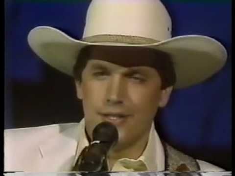 Amarillo By Morning - George Strait. I remember this performance well. CMA Awards in '86. I believe he won Male Vocalist of the Year. It was just a few months after his 13 year old daughter Jennifer was killed in a car accident.