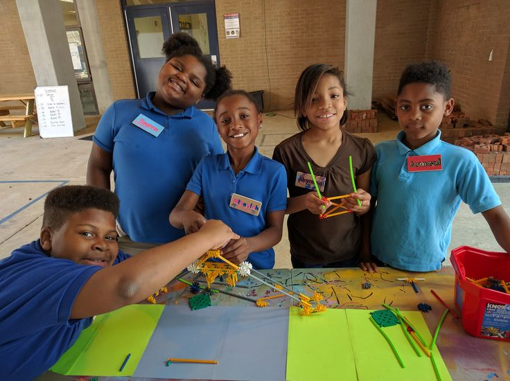 Students at Connolly Elementary show off their in-progress prototypes for the Bridge Big Build.