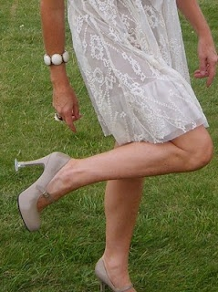 heel stoppers for grass, maybe not cute but will save the life of your heels