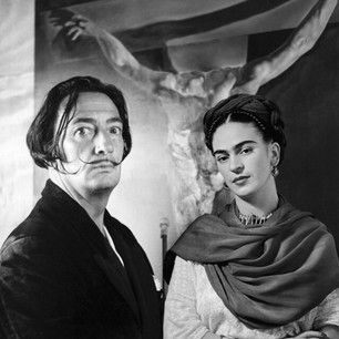Salvador Dali & Frida Kahlo together in front of one of his paintings.