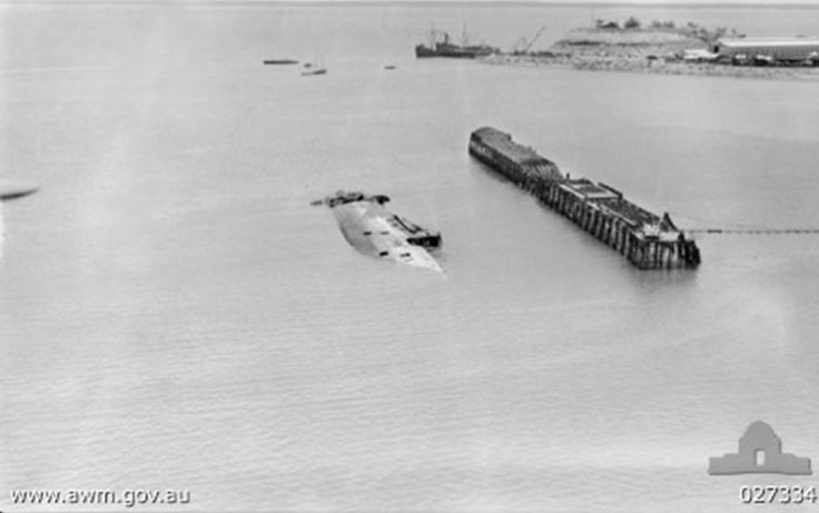 A sunken ship (MV Neptuna) and burnt-out wharf in Darwin Harbour following the attack. From Wikipedia.