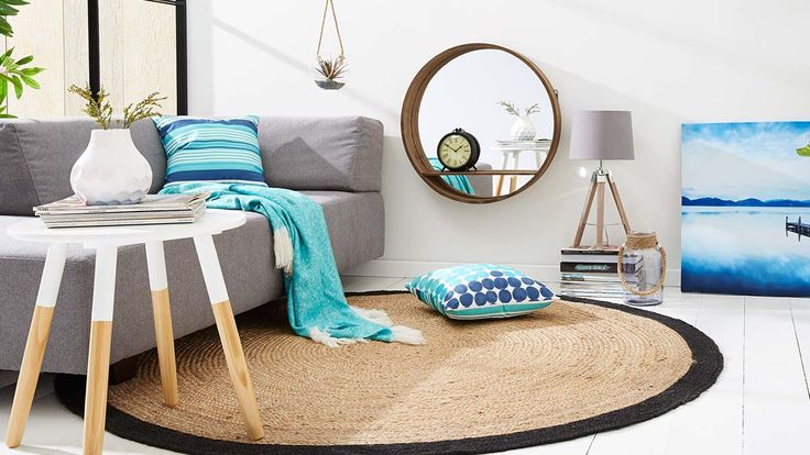 Living room in beachy Kmart Australia style. Love the unusual placement of the mirror shelf