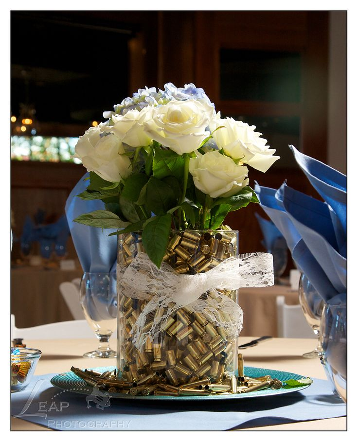 Perfect for a western wedding :  Bullet casings in a vase |  wedding centerpiece | Boise Wedding Photographers | copyright 2015 Leap Photography