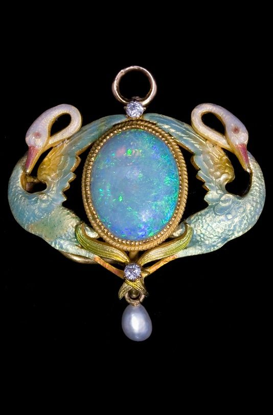 Art Nouveau brooch-pendant. Set in yellow gold with plique-à-jour, opal, diamond and pearl. This brooch is not clearly marked, but there are brooches in this same style from the American firm Krementz & Company.