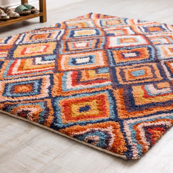 Jebel Diamond Berber Rug Let go and allow your toes to get lost in the tufted woollen pile, the rug is fairly traded and traditionally woven in India.