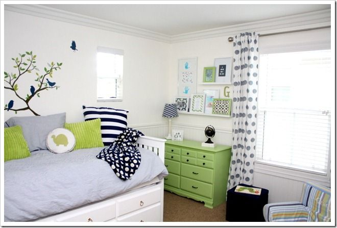 I love the mixture of more neutral greys with pops of green and blue (my favorite colors!) And I ADORE those polka-dot curtains!