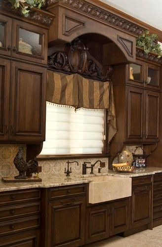 Old World traditional kitchen... Love the glass front cabinets at the top. I need these!