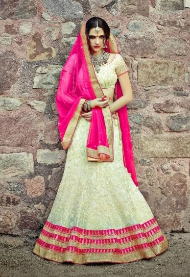 Glamorous cream color net Lehenga with Resham embroidered creeper design. Item Code: GXP7396