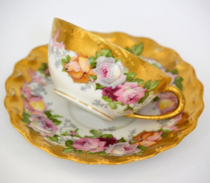 Limoges Hand Painted Cup and Saucer with Roses and heavy gilding