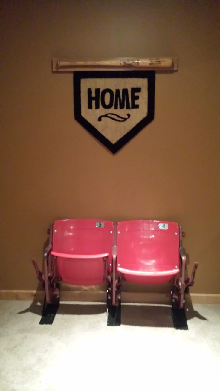 "Old Busch Stadium seats, ""home"" rug from uncommongoods.com and a baseball bat from my husbands youth. Makes a great ""nook"" area to display our love for baseball."