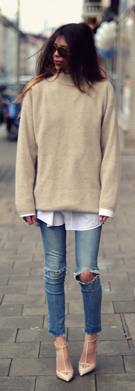 Maja Wyh is wearing an oversized beige jumper, jacket from Diesel, vintage shirt, jeans from Cheap Monday and shoes from Zara