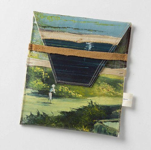 Very clever idea. Recycled painting as iPad case.