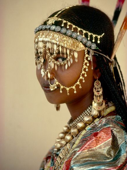 Traditional African bride dressed in a veil of gold.