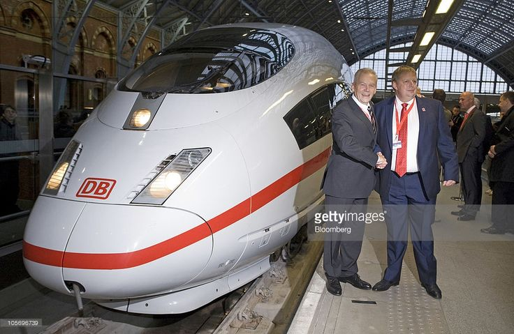 Ruediger Grube, chief executive officer of Deutsche Bahn AG, left, and Paul Chapman, managing director of HS 1 Ltd., shake hands in front of one of Deutsche Bahn's Intercity Express 3 trains at St Pancras station in London, U.K., on Tuesday, Oct. 19, 2010. Groupe Eurotunnel SA's chief executive officer, Jacques Gounon, said he sees 'no safety issue' to keep Deutsche Bahn AG's trains from using its subsea link and offering services connecting London to Germany. Photographer: Chris…