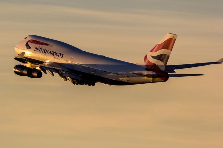 A picture of a British Airways Boeing 747-436 airplane climbing out into the sunset after departure from Los Angeles (LAX/KLAX). The aircraft registration is G-BNLY