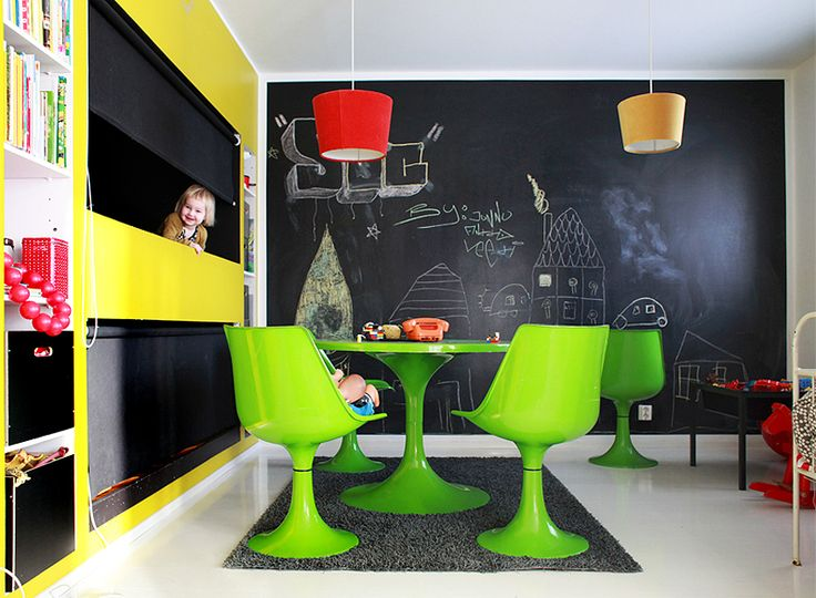 This room is awesome. A chalkboard wall and sleeping nooks!