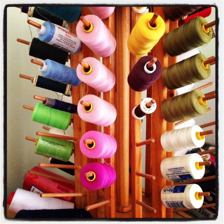 Rainbow of coloured cottons on hand. Love this cotton reel holder.