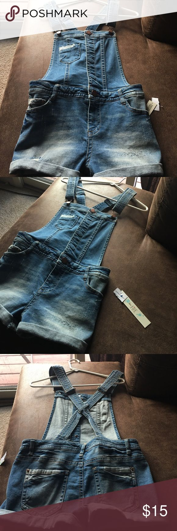 Jean Jumper Denim Jean Jumper for the summer!  Purchased at Nordstrom Rack and never worn! NWT! Perfect for a teenager or a vacation look with a pair of converses, flip flops or make it sexy with a pair of pumps! Your choice, but you can't go wrong! I lose weight, so I may need a small or XS in this brand. Happy Shopping!  Love Fire Shorts Jean Shorts