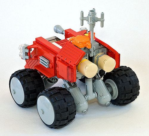 https://flic.kr/p/5ap9xh   Rear   Rear view with suspension and storage tanks for... umm.. oxygen? And stuff. You can also see the big heatsinks on the rear traction motors.