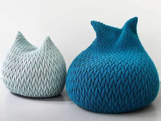 bean bag like chairs with a woven cover reminiscent of coarse knitting. Produced by Belgian carpet maker Casalis.