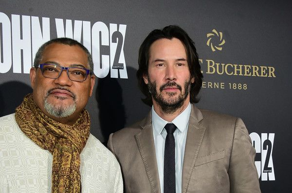 """Keanu Reeves Photos Photos - From the cast, actor Keanu Reeves and Laurence Fishburne pose on arrival for the premiere of the film """"John Wick Chapter Two"""" in Hollywood, California on January 30, 2017. / AFP / Frederic J. Brown - Premiere Of Summit Entertainment's 'John Wick: Chapter Two' - Arrivals"""