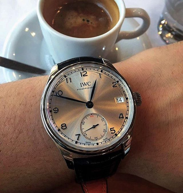 #coffeeandhorology to kick off your week from @iwcgirl with this amazing shot of the IWC Portugieser Hand-Wound Eight Days 'BFI London Film Festival 2015' Limited Edition. The expanse of the silvery-white sunburst dial is just gorgeous, and while this post is predominantly watch-focused, I just want to express my condolences to London and those who were affected by the recent. I take solace in the fact that there is beauty in the world even in its darkest of days. 🇬🇧❤️🌎🌍🌏❤️ . . And…