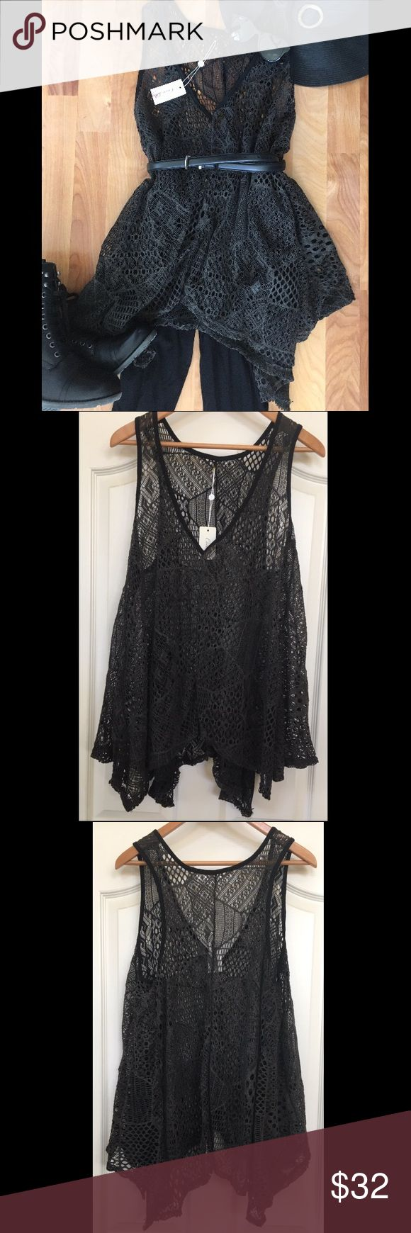 Filigree Boutique Tunic Tank Top from Coco Roja, bought from a little boutique. NWT, although the tag was cut in half. Perfect condition! This sheer flowy tank looks amazing with a belt and leggings. Very unique fabric, has a crochet lacework effect with varying patters throughout the top. The threads are black with grey entangled in. Fits M, L, and a smaller XL. Coco Roja Tops Tunics