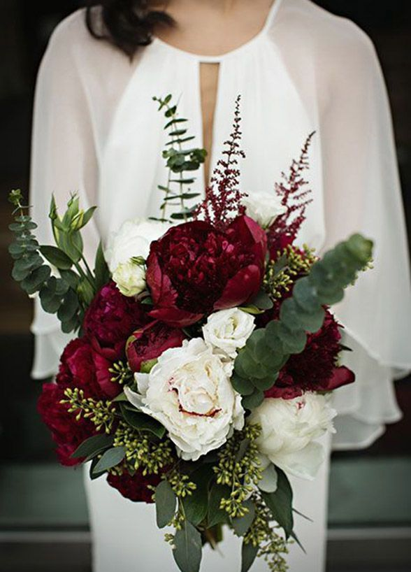 These deep red and white flowers contrast perfectly to make a gorgeous winter wedding bouquet.