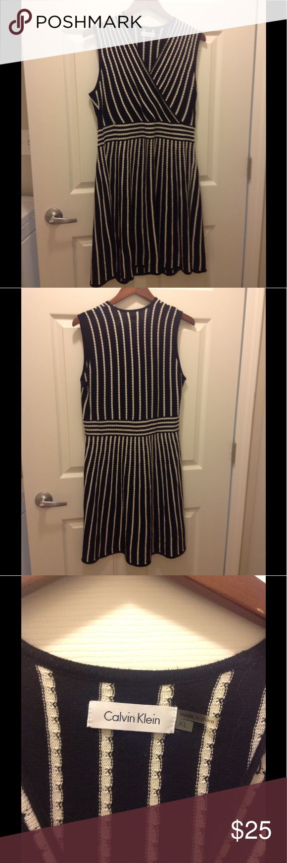Calvin Klein Women's V-Neck Dress Size Xlg Beautiful Women's Calvin Klein 100% Acrylic V-neck Dress.  Can be worn dressed up or just casually with flats.  This is an extremely easy dress to take care of, don't miss this bargain!! Calvin Klein Dresses Midi