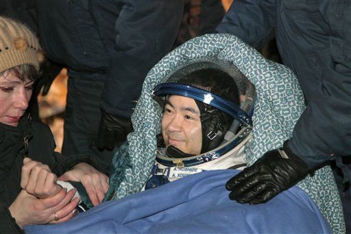 Japanese astronaut Aki Hoshide smiles after landing in a Soyuz capsule outside the town of Arkalyk, Kazakhstan, on Monday, Nov. 19, 2012. Hoshide along with NASA's Sunita Williams, and Russian astronaut Yury Malenchenko touched down in the dark, chilly expanses of central Kazakhstan onboard a Soyuz capsule Monday after a 125-day stay at the International Space Station. (AP Photo/Maxim Shipenkov)