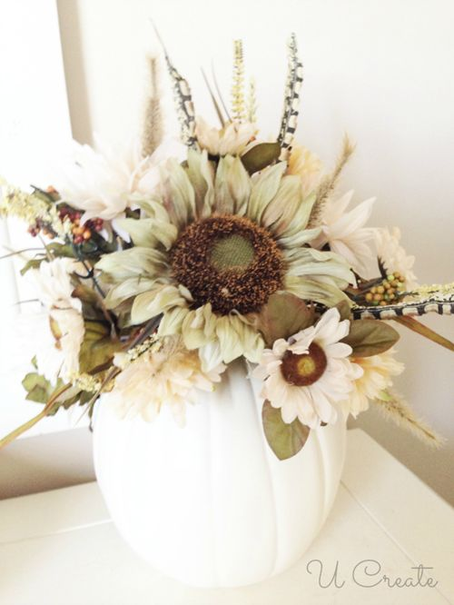 I am sooo making this for fall this year :)  I love the white pumpkin and the big flowers!!!