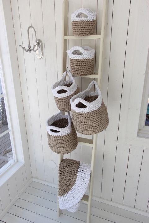 I know this pin is for the crocheted baskets but, I love that coat hook on the wall beside the baskets! Very cool.