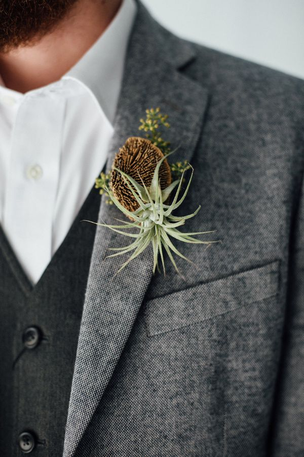 air plant boutonniere - photo by Monika Gauthier Photography http://ruffledblog.com/earthy-industrial-bohemian-wedding-inspiration