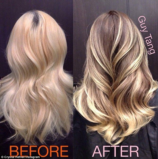 Still highlighted: The former Playmate of the Month has been posting numerous images of her new darker locks, but she still can't resist clipping in blonde hair extensions to lighten the look