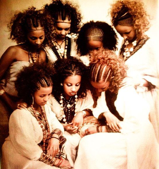 Beautiful Tigraian women showing their hair style. This picture shows the many hair style braids that can be worn by women and young girls in Tigrai (one of the northern regions of Ethiopia). Even though modern hair styles can be seen in many of the surrounding cities,  in the municipality of Tigrai most women stick to the thousands-year-old traditional styles.