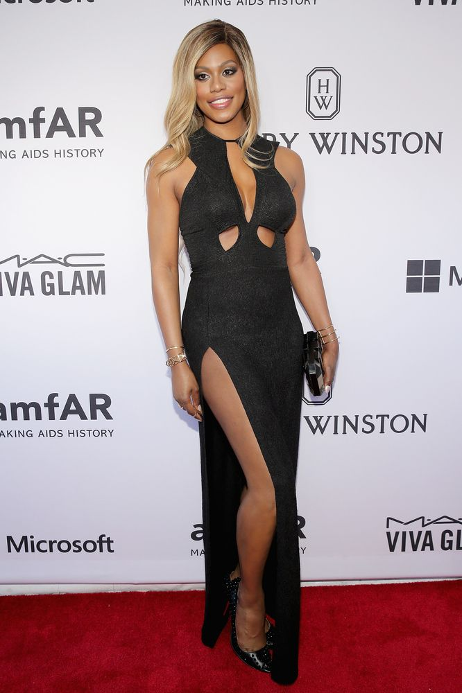 "Laverne Cox gives a lesson in ""go big or go home"" with the cutouts and slit in her Michael Costello gown"