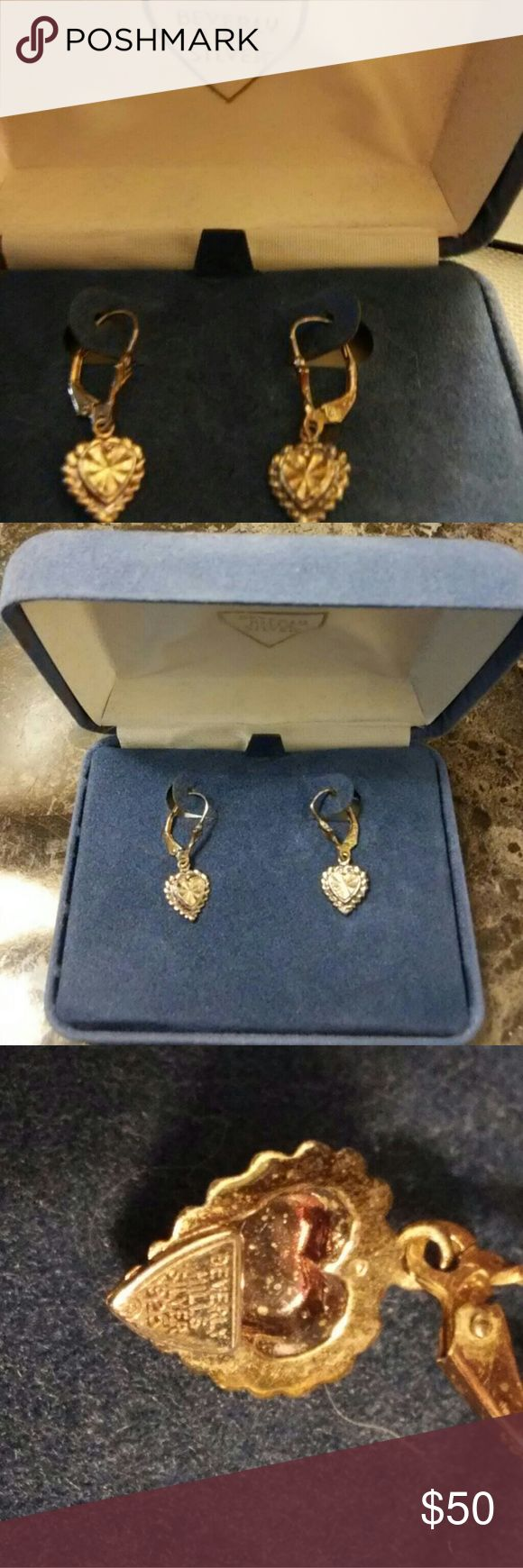 """Vtg Beverly Hills .925 Silver Heart Earrings Vintage pair of Beverly Hills .925 Sterling Silver Heart Earrings in original box.  The dangling heart earrings have a lever style backing.  They have a pretty diamond cut design in the center of the heart.  These are stamped on the back to show maker and .925.  They measure approx 1/2"""" by 11/16"""" top to bottom.   They are in good vintage condition but do to show normal wear and toning due to use and age.   They include original box beverly hills…"""