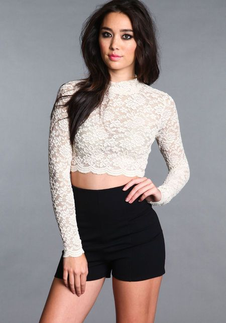 * Stretched lace long sleeve crop top with matte nylon/spandex bra top * Mock neck collar has snaps with a split opening in back * All sizes are fully lined in the front bra top Imported. Fabric: Nylon/Polyester/Spandex.