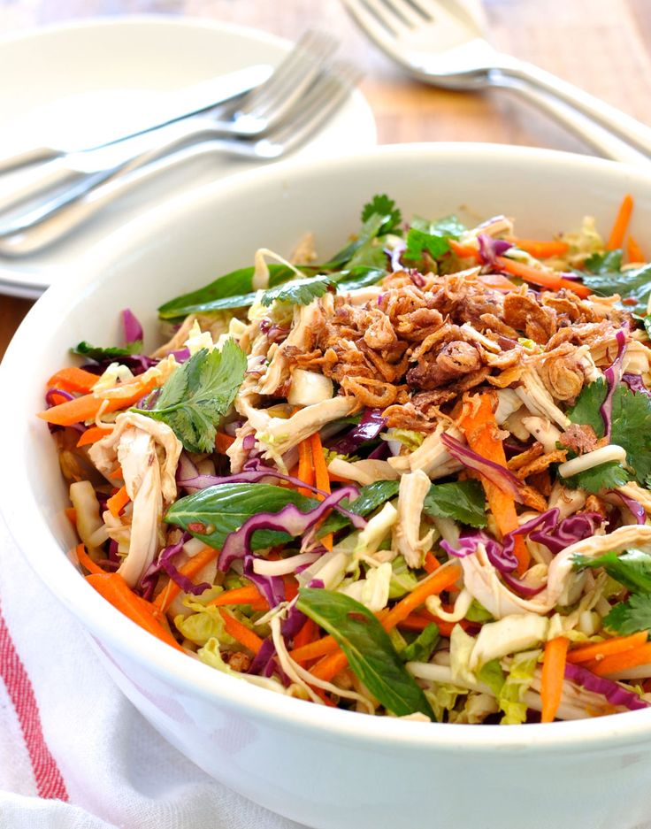 Crunchy cabbage and carrots with shredded chicken dressed with a fabulous Asian dressing. Delicious AND healthy! #salad
