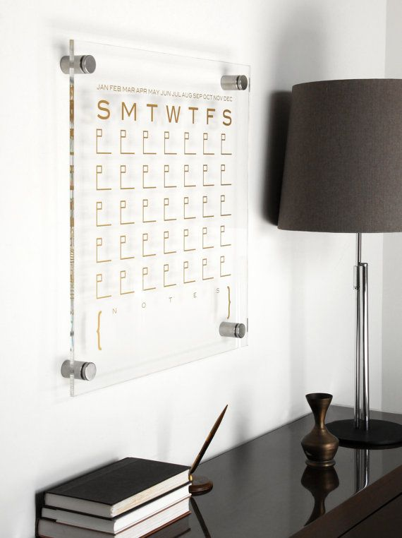 The DTBD Pure Wall Calendar brings art and function to any environment. Each calendar is made of crystal clear polished Lucite with solid