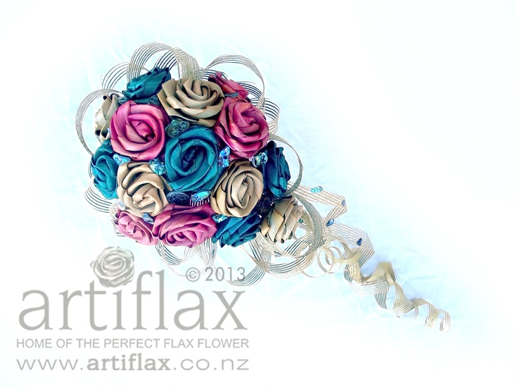 Flax flowers by Artiflax    Teardrop styled wedding bouquet made with a mix of natural, pale pink and turquoise flax flowers with Hapene and paua shells.