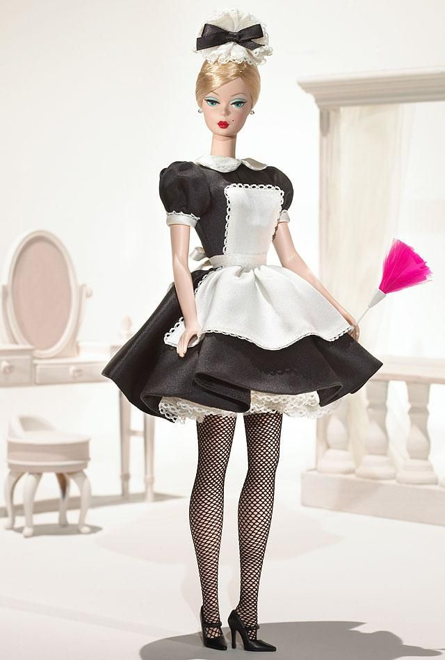 ~ French Maid Barbie® ~ designed by Robert Best, celebrates the working woman. The uniform includes crisp black dress, accented with white collar, apron, and petticoat. Black mary janes and feather duster complete the ensemble.
