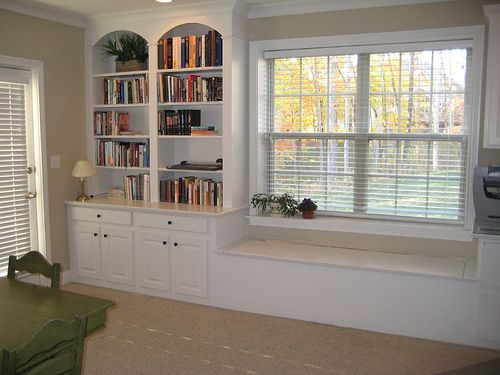 I'm really digging this window seat, but I would build in DVD storage instead of bookshelves. I can see board games stored in those lower cabinets!