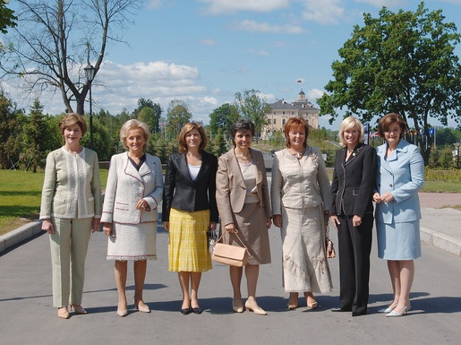 The G8 summiteers' wives have their official photograph taken. Left to right, Laura Bush, wife of the U.S. President; Bernadette Chirac, wife of the President of France; Maria Margarita Souza Uva Barroso, wife of the European Commission President; Flavia Franzoni, wife of the Prime Minister of Italy; Lyudmila Putina, wife of the President of Russia; Laureen Harper, wife of the Prime Minister of Canada; and Cherie Blair, wife of the Prime Minister of Great Britain, 2006