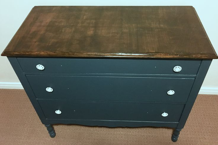 Refinished dresser saved from the side of the road, has its bumps and bruises but tons of charm.