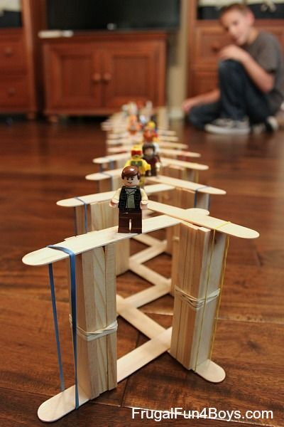 Simple Chain Reactions with Craft Sticks - These LEGO guys are about to go for a wild ride! Video demo in the post.