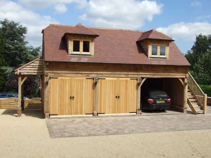 Two-storey wooden garage. More timber garages at www.quick-garden.co.uk