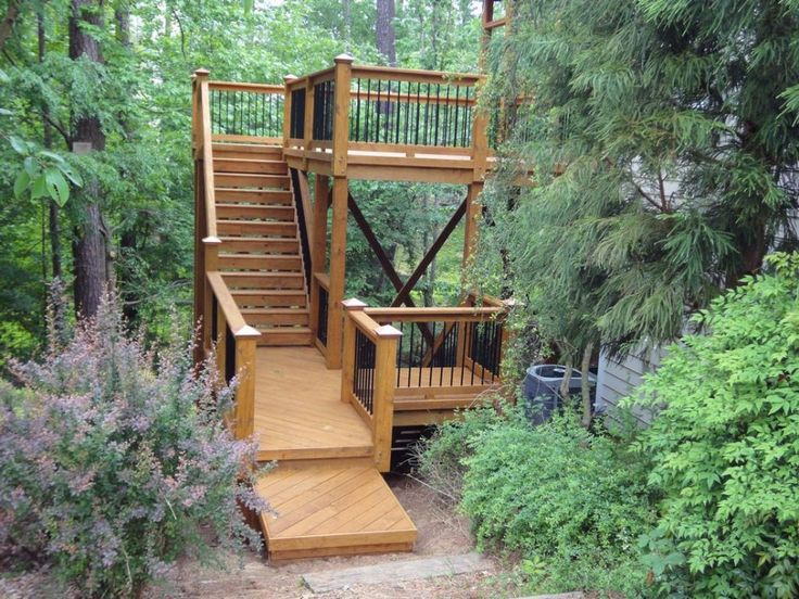 Exterior:Exterior Amazing Deck With Stair Decoration For Outdoor Living Space Design With Black Iron Stick Handrail Light Brown Wood Step An...